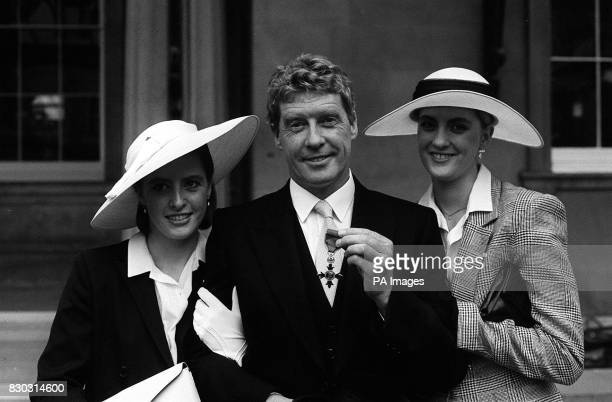 Actor Michael Crawford with the OBE he received from the Queen at Buckingham Palace arm in arm with his two daughters Lucy and Emma 21