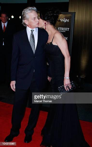 Actor Michael Douglas and actress Catherine Zeta Jones attend the Wall Street Money Never Sleeps premiere at the Ziegfeld Theatre on September 20...