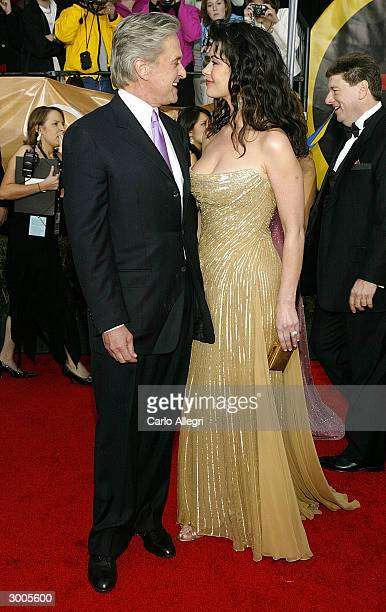 Actor Michael Douglas and actress Catherine ZetaJones attend the 10th Annual Screen Actors Guild Awards on February 22 2004 at the Shrine Auditorium...