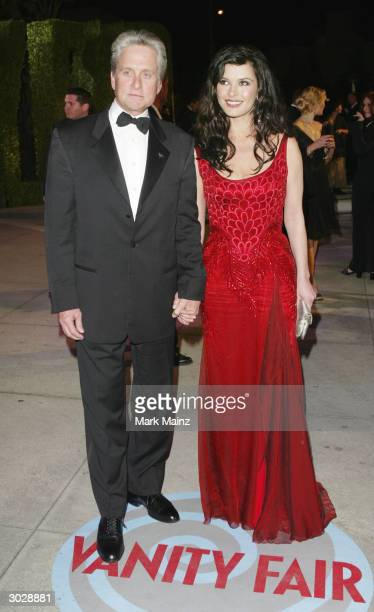Actor Michael Douglas and Catherine ZetaJones attends the 2004 Vanity Fair Oscar Party at Mortons Restaurant February 29 2004 in Hollywood California