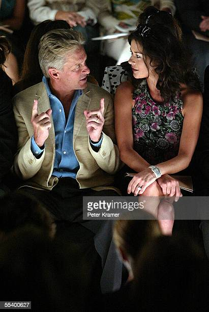 Actor Michael Douglas and his wife actress Catherine Zeta Jones attend the Michael Kors Spring 2006 fashion show during Olympus Fashion Week at the...