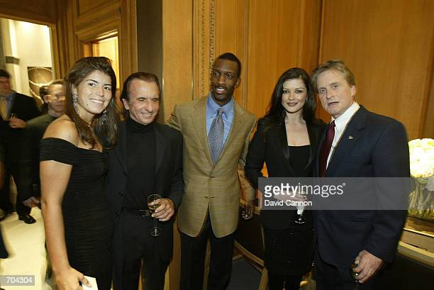 Actor Michael Douglas and his wife actress Catherine ZetaJones track star Michael Johnson Brazilian race car driver Emerson Fittipaldi and his...