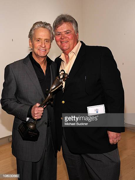 Actor Michael Douglas and producer Joel Douglas attend the Icon Award Presentation during the 22nd Annual Palm Springs International Film Festival at...