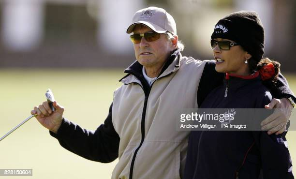 Actor Michael Douglas and wife Catherine Zeta Jones keep warm during a practise session on the Old Course at St Andrews Fife Tuesday September 27...
