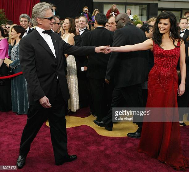Actor Michael Douglas and wife Catherine ZetaJones attend the 76th Annual Academy Awards at the Kodak Theater on February 29 2004 in Hollywood...
