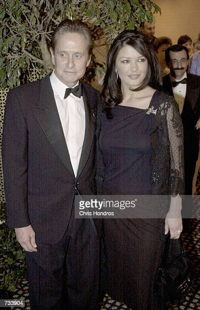 Actor Michael Douglas and wife/actress Catherine ZetaJones arrive at the United Nations Ambassadors Dinner October 26 2000 in New York