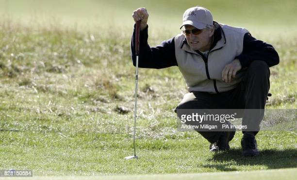 Actor Michael Douglas lines up a putt during a practise round on the Old Course at St Andrews Fife Tuesday September 27 2005 The Dunhill Links...