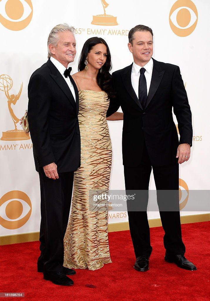 Actor Michael Douglas, Luciana Damon, and actor Matt Damon arrive at the 65th Annual Primetime Emmy Awards held at Nokia Theatre L.A. Live on September 22, 2013 in Los Angeles, California.