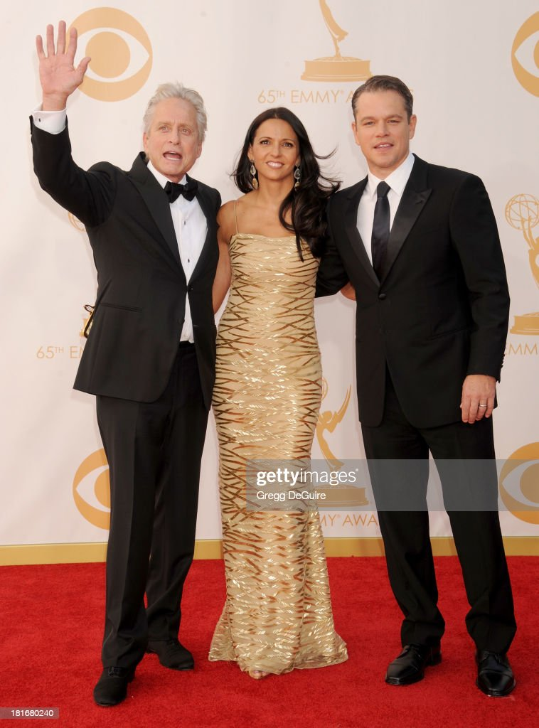 Actor Michael Douglas, Luciana Damon and actor Matt Damon arrive at the 65th Annual Primetime Emmy Awards at Nokia Theatre L.A. Live on September 22, 2013 in Los Angeles, California.