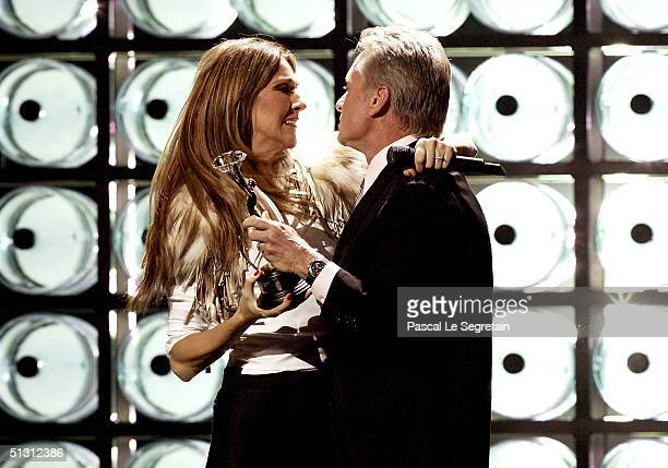 Actor Michael Douglas presents Canadian pop diva Celine Dion the Diamond Award a special honor for being the topselling female artist of all time...