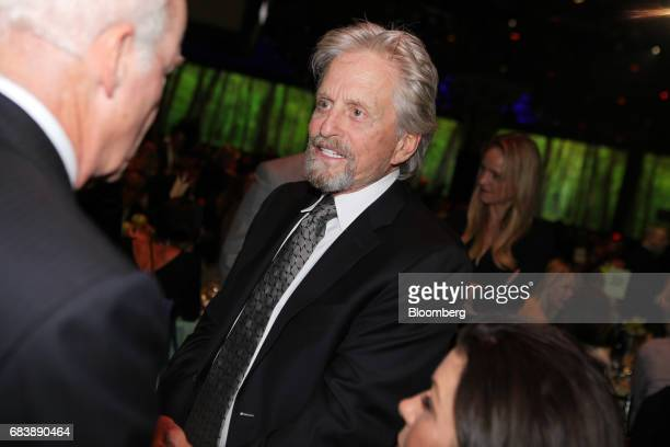 Actor Michael Douglas speaks with an attendee during the Robin Hood Foundation's 'Love and Leadership' benefit in New York US on Monday May 15 2017...