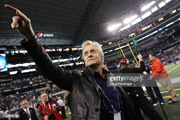 Actor Michael Douglas walks on the sidelines before the Pittsburgh Steelers play against the Green Bay Packers in Super Bowl XLV at Cowboys Stadium...