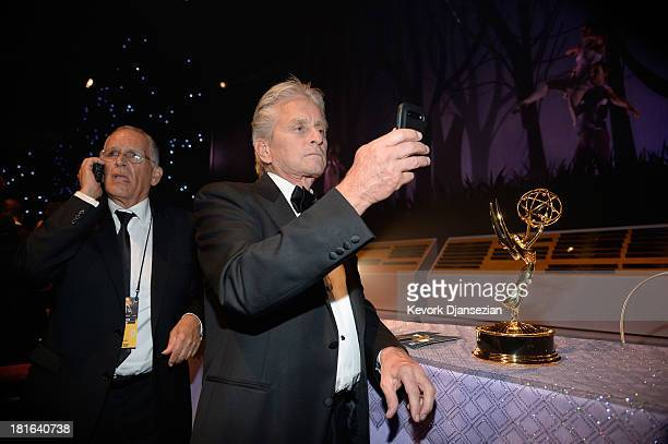 Actor Michael Douglas winner of the Best Lead Actor in a Miniseries or Movie Award for 'Behind The Candelabra' attends the Governors Ball during the...
