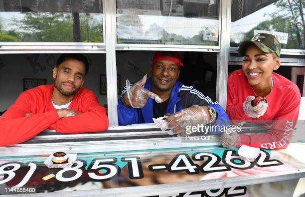 Actor Michael Ealy director Deon Taylor and actress Meagan Good hands out signature The Intruder cupcakes during The Intruder Clark Atlanta...