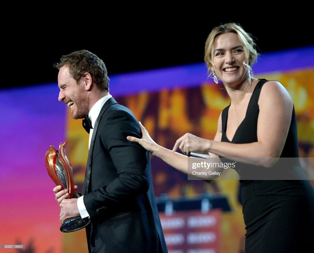 Actor Michael Fassbender (L) accepts the International Star Award from actress Kate Winslet onstage at the 27th Annual Palm Springs International Film Festival Awards Gala at Palm Springs Convention Center on January 2, 2016 in Palm Springs, California.