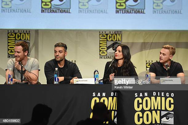 Actor Michael Fassbender actor Oscar Isaac actress Olivia Munn and actor Ben Hardy from XMen Apocalypse speak onstage at the 20th Century FOX panel...