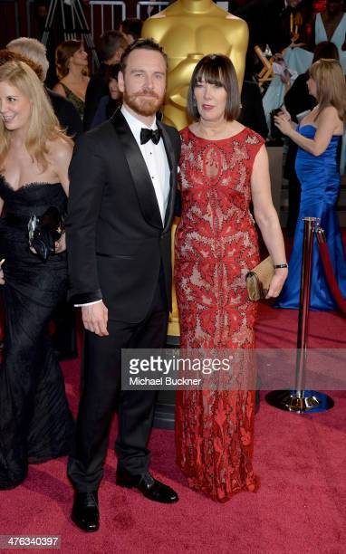 Actor Michael Fassbender and Adele Fassbender attend the Oscars held at Hollywood Highland Center on March 2 2014 in Hollywood California