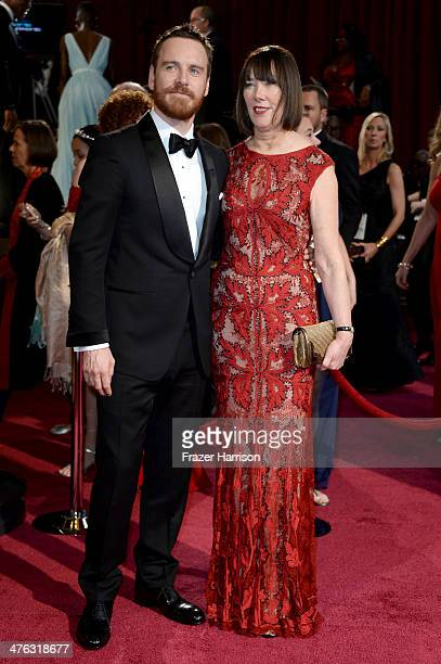 Actor Michael Fassbender and his mother Adele attend the Oscars held at Hollywood Highland Center on March 2 2014 in Hollywood California