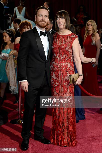 Actor Michael Fassbender and his mother Adele Fassbender attend the Oscars held at Hollywood Highland Center on March 2 2014 in Hollywood California