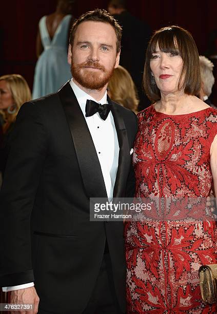 Actor Michael Fassbender and his mother Adele Fassbender attends the Oscars held at Hollywood Highland Center on March 2 2014 in Hollywood California