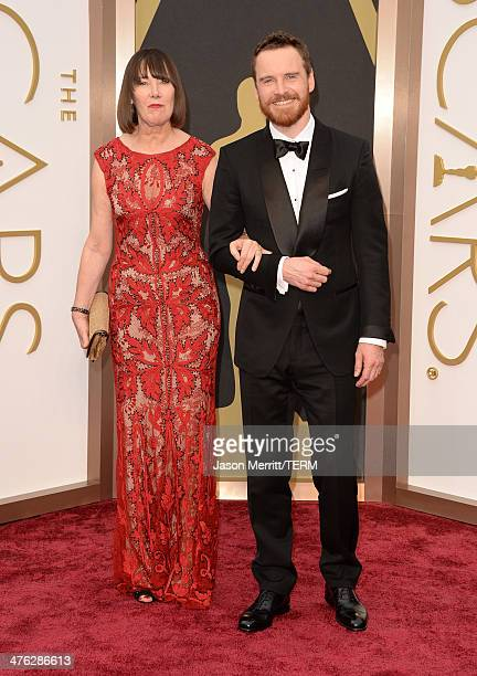 Actor Michael Fassbender and his mother Adelle attend the Oscars held at Hollywood Highland Center on March 2 2014 in Hollywood California