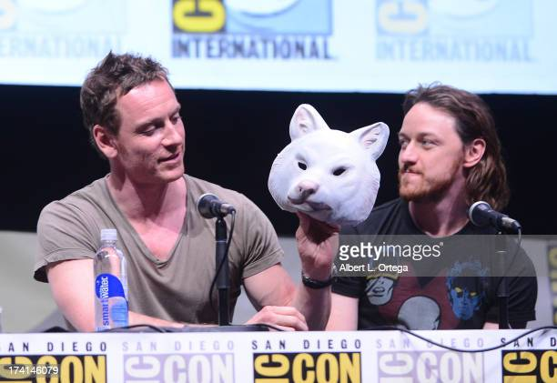 Actor Michael Fassbender and James McAvoy speak at the 20th Century Fox panel during ComicCon International 2013 at San Diego Convention Center on...