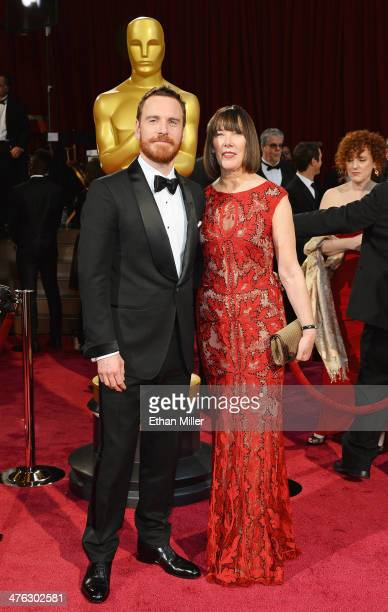 Actor Michael Fassbender and mother Adele attend the Oscars held at Hollywood Highland Center on March 2 2014 in Hollywood California