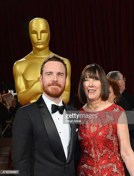 Actor Michael Fassbender and mother Adele Fassbender attend the Oscars held at Hollywood Highland Center on March 2 2014 in Hollywood California