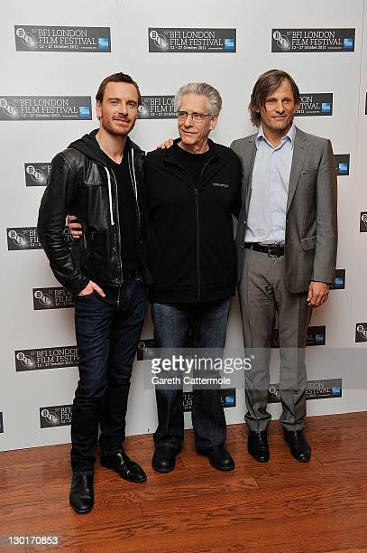 Actor Michael Fassbender director David Cronenburg and actor Viggo Mortenson attend the photocall for A Dangerous Method at the 55th BFI London Film...