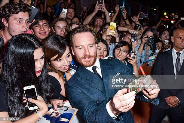Actor Michael Fassbender interacts with fans at the 'Trespass Against Us' premiere during the 2016 Toronto International Film Festival at Princess of...