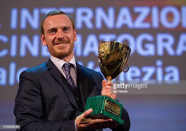 Actor Michael Fassbender of Shame poses with the Coppa Volpi for Best Actor during the Closing Ceremony during the 68th Venice Film Festival at...