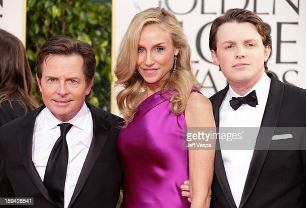 Actor Michael J Fox actress Tracy Pollan and Mr Golden Globe Sam Fox arrive at the 70th Annual Golden Globe Awards held at The Beverly Hilton Hotel...