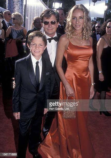 Actor Michael J Fox actress Tracy Pollan and son Sam Fox attend the 51st Annual Primetime Emmy Awards on September 12 1999 at Shrine Auditorium in...