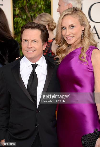 Actor Michael J Fox and actress Tracy Pollan arrive at the 70th Annual Golden Globe Awards held at The Beverly Hilton Hotel on January 13 2013 in...