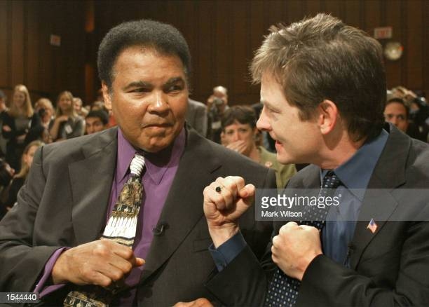 Actor Michael J Fox and boxer Muhammad Ali pretend to spar before giving their testimony before the Senate Appropriations Subcommittee on Health and...