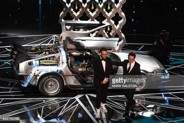 TOPSHOT US actor Michael J Fox and Canadian actor Seth Rogen arrive on stage aboard a DeLorean car to present the Best Film Editing award at the 89th...