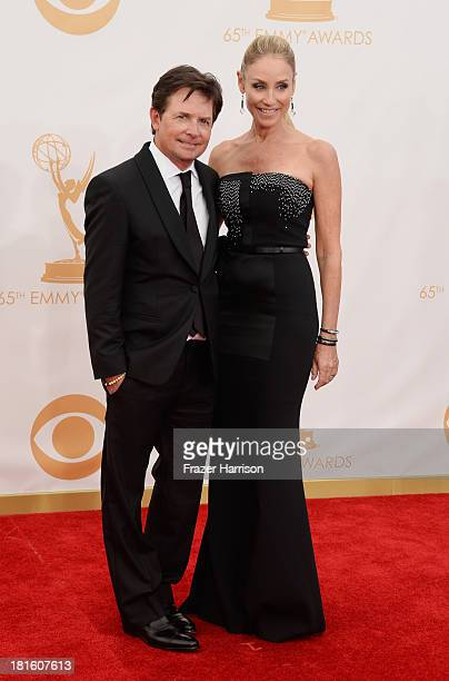 Actor Michael J. Fox and Tracy Pollan arrive at the 65th Annual Primetime Emmy Awards held at Nokia Theatre L.A. Live on September 22, 2013 in Los...