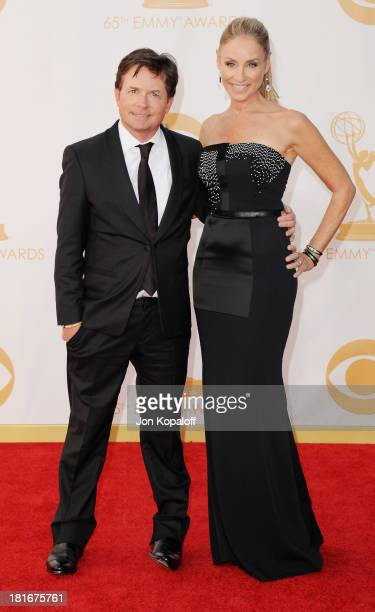 Actor Michael J Fox and wife actress Tracy Pollan arrive at the 65th Annual Primetime Emmy Awards at Nokia Theatre LA Live on September 22 2013 in...
