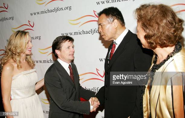 Actor Michael J Fox and wife actress Tracy Pollan greet Muhammad Ali and wife Yolanda at A Funny Thing Happened On The Way To Cure Parkinson's...