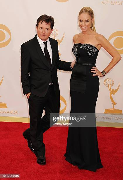 Actor Michael J. Fox and wife Tracy Pollan arrive at the 65th Annual Primetime Emmy Awards at Nokia Theatre L.A. Live on September 22, 2013 in Los...