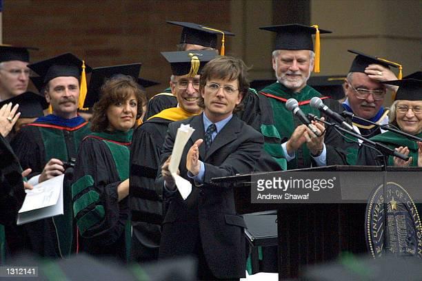 Actor Michael J Fox applauds graduates after speaking at the UCLA School of Medicine Hippocratic Oath Ceremony June 1 2001 in Westwood CA