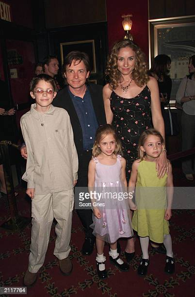 Actor Michael J Fox arrives with his family wife Tracy son Sam and twin daughters Schuyler and Aquinnah at the New York premiere of the new Disney...
