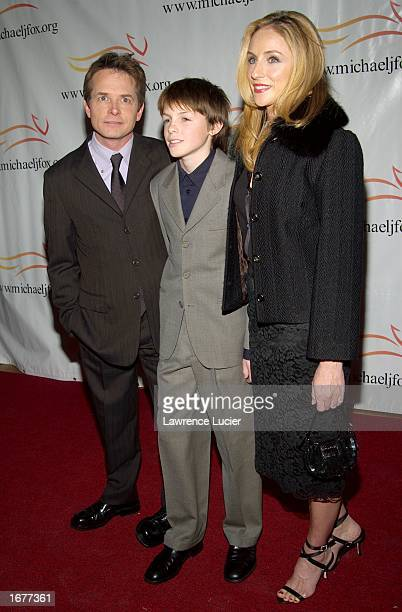 Actor Michael J Fox his son Sam and wife actress Tracy Pollan arrive at A Funny Thing Happened On The Way To Cure Parkinson's benefit gala on...