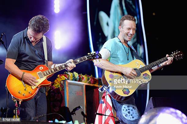 Actor Michael J Fox performs onstage with recording artist Chris Martin of Coldplay during the Coldplay 'A Head Full of Dreams' Tour at MetLife...