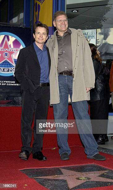 Actor Michael J Fox poses with director Robert Zemeckis at the ceremony honoring Fox with a star on the Hollywood Walk of Fame on December 16 2002 in...