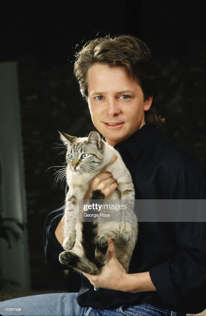 Actor Michael J. Fox poses with his cat during a 1988 Beverly Hills, California, photo portrait session. Fox, a three-time Emmy Award winner for his work on TV's 'Family Ties,' also starred in the 'Back to the Future' film trilogy.