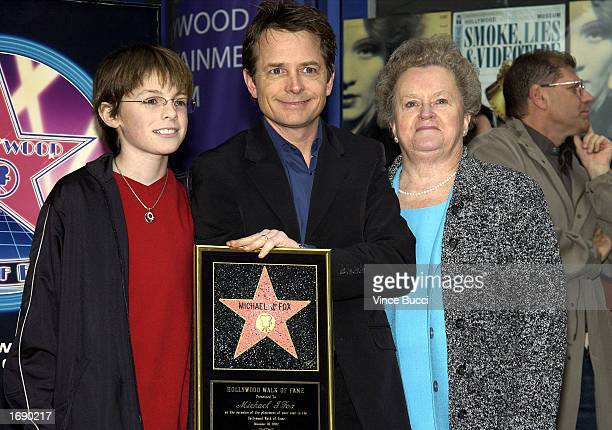 Actor Michael J Fox poses with son Sam and mother Phyllis at the ceremony honoring him on the Hollywood Walk of Fame on December 16 2002 in Hollywood...