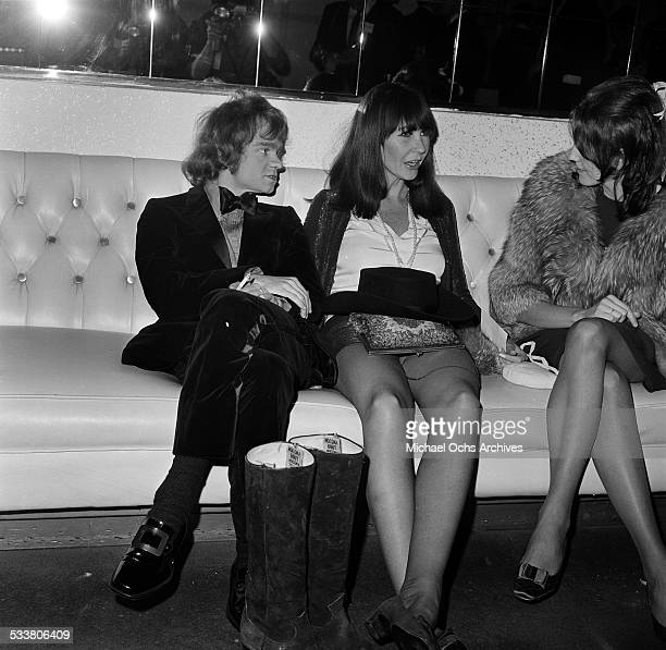 Actor Michael J Pollard sits with costume designer Theadora Van Runkle and his wife actress Beth Howland talk during an event in Los AngelesCA