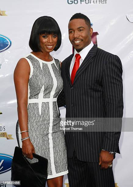 Actor Michael Jai White and actress Tasha Smith walk the blue carpet at the 10th Annual Ford Hoodie Awards at MGM Garden Arena on August 4, 2012 in...