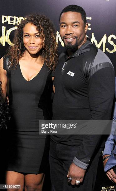 Actor Michael Jai White and wife Courtenay Chatman arrive at the Los Angeles premiere of 'Tyler Perry's The Single Moms Club' held on March 10 2014...